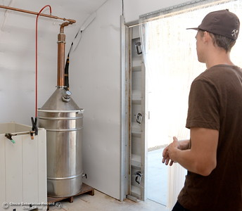 Nate Deck talks about the still they use to make their liquor during a tour of the Cobble Ridge Distillery in Bangor, Calif. Thurs. Sept. 29, 2016. (Bill Husa -- Enterprise-Record)