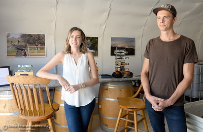 Moonshiners Hailey Hickman and Nate Deck explain the process of making moonshine near the facility during a tour of the Cobble Ridge Distillery in Bangor, Calif. Thurs. Sept. 29, 2016. (Bill Husa -- Enterprise-Record)
