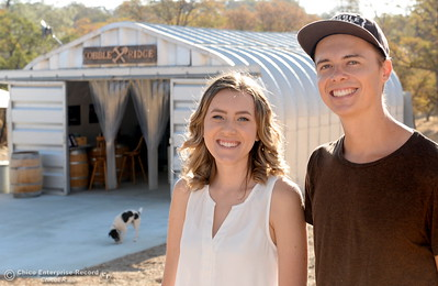 Moonshiners Hailey Hickman and Nate Deck smile near the facility during a tour of the Cobble Ridge Distillery in Bangor, Calif. Thurs. Sept. 29, 2016. (Bill Husa -- Enterprise-Record)