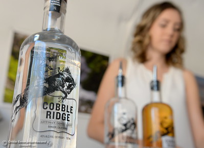 Operations Manager Hailey Hickman pours a taste of  moonshine during a tour of the Cobble Ridge Distillery in Bangor, Calif. Thurs. Sept. 29, 2016. (Bill Husa -- Enterprise-Record)