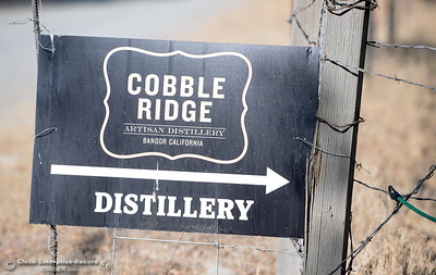 A sign is seen near the entrance to the distillery seen during a tour of the Cobble Ridge Distillery in Bangor, Calif. Thurs. Sept. 29, 2016. (Bill Husa -- Enterprise-Record)