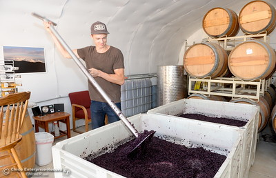 Nate Deck smiles as he stirs up the mash during a tour of the Cobble Ridge Distillery in Bangor, Calif. Thurs. Sept. 29, 2016. (Bill Husa -- Enterprise-Record)