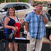 Kathy and Scott Plath of Lowell, owners of Cobblestones and Moonstones, address the crowd that came out for the restaurant's 25th anniversary bash.