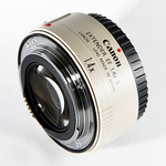 """<b>Canon Extender EF 1.4x II</b> <div class=""""gsFont""""> Though not technically a """"lens,"""" this little doodad attaches to a telephoto lens, giving you an even longer (but slower) telephoto lens. Optically, there is little (if any) perceptible degradation when this adapter is mounted to any of my L–lenses. At the cost of one f–stop, I get 40% more reach and nearly the same image quality as the un-extended lens. Lighter and cheaper than doubling my lens count, the EF1.4xII is easily the most cost-effective chunk of white glass to take up residence in my lens case. <br><div class=""""gsGray""""><em>Rating: 10 out of 10</em></div> </div>"""