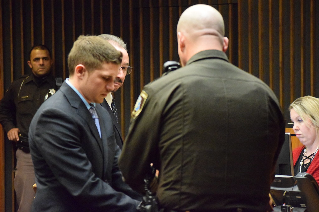 . Cody Soucie, 26, is handcuffed in court after being sentenced to at least 53 months in prison. Photo by Jameson Cook / Macomb Daily.