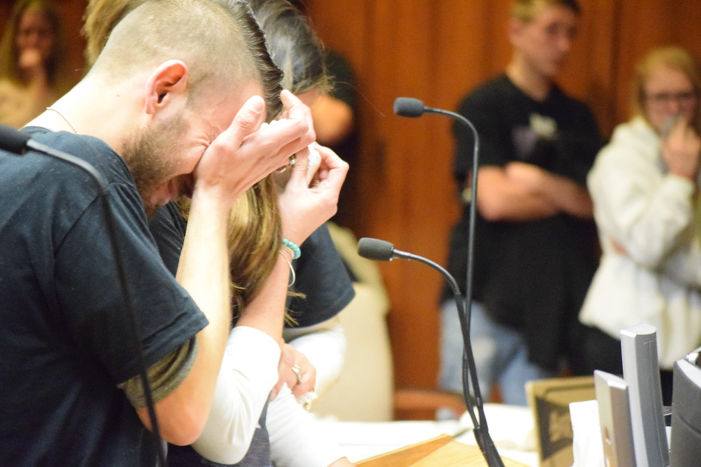 . The victim\'s uncle and aunt, Anthony and Jessica Jelsone, cry as they deliver their victim impact statement. Ryan Mannes was 14 years old when he was killed after being struck by a motorcyle in Roseville. Photo by Jameson Cook / Macomb Daily.