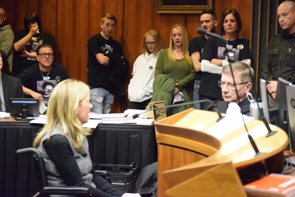 . A friend and neighbor of the victim\'s family talks to Circuit Judge Carl Marlinga as supporters of the victim look on. Photo by Jameson Cook / Macomb Daily.