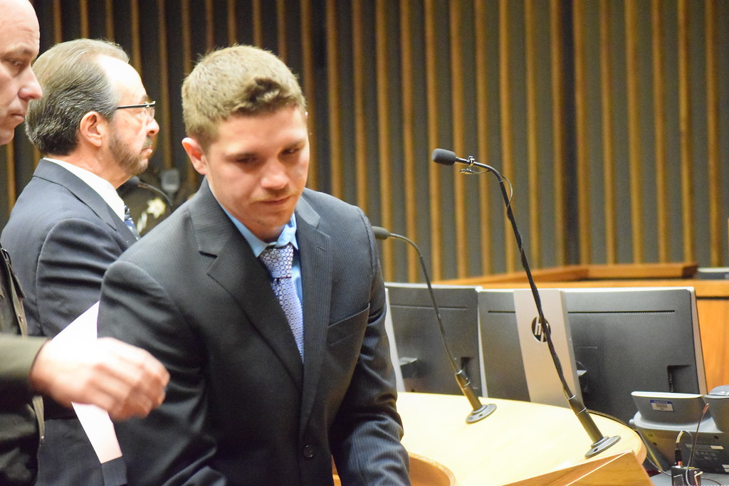 . Cody Soucie is led to prison, where he will be for more than four years.  Photo by Jameson Cook / Macomb Daily.