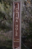"""C, Mile Trail, nearly to China Hole, on the sign """"CHINA HOLE"""" has been scratched, and the KM distance has peeled off; the 0.3 mi distance is curling off but is still fully legible."""