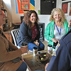 """Wednesday was """"Coffee with a Cop"""" and in Fitchburg they held their event at Strong Style Coffee on Cushing Street. Sheri Fleck of Leominster, Cindy Billiel of Winchendon and katie Noe of New Hampshire have a good laugh with Fitchburg Office Fred Lake during the event. SENTINEL & ENTERPRISE/JOHN LOVE"""