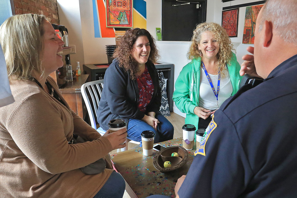 """. Wednesday was \""""Coffee with a Cop\"""" and in Fitchburg they held their event at Strong Style Coffee on Cushing Street. Sheri Fleck of Leominster, Cindy Billiel of Winchendon and katie Noe of New Hampshire have a good laugh with Fitchburg Office Fred Lake during the event. SENTINEL & ENTERPRISE/JOHN LOVE"""