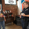 """Wednesday was """"Coffee with a Cop"""" and in Fitchburg they held their event at Strong Style Coffee on Cushing Street. Patrolman James Farrell chats with Brenda Coveno-Watson of Fitchburg during the event. SENTINEL & ENTERPRISE/JOHN LOVE"""
