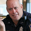 """Wednesday was """"Coffee with a Cop"""" and in Fitchburg they held their event at Strong Style Coffee on Cushing Street. Officer Fred Lake chats with customers during the event. SENTINEL & ENTERPRISE/JOHN LOVE"""