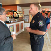 """Wednesday was """"Coffee with a Cop"""" and in Fitchburg they held their event at Strong Style Coffee on Cushing Street. Fitchburg Mayor Stephen DiNatale chats with Police Chief Ernest Martineau during the event. SENTINEL & ENTERPRISE/JOHN LOVE"""
