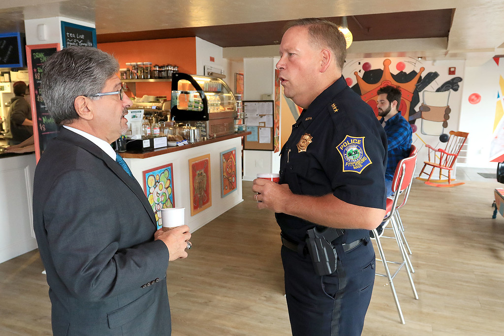 """. Wednesday was \""""Coffee with a Cop\"""" and in Fitchburg they held their event at Strong Style Coffee on Cushing Street. Fitchburg Mayor Stephen DiNatale chats with Police Chief Ernest Martineau during the event. SENTINEL & ENTERPRISE/JOHN LOVE"""