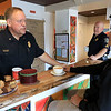 """Wednesday was """"Coffee with a Cop"""" and in Fitchburg they held their event at Strong Style Coffee on Cushing Street. Fitchburg Police Chief Ernest Martineau chats with Adrian Gates of Fitchburg during the event. SENTINEL & ENTERPRISE/JOHN LOVE"""