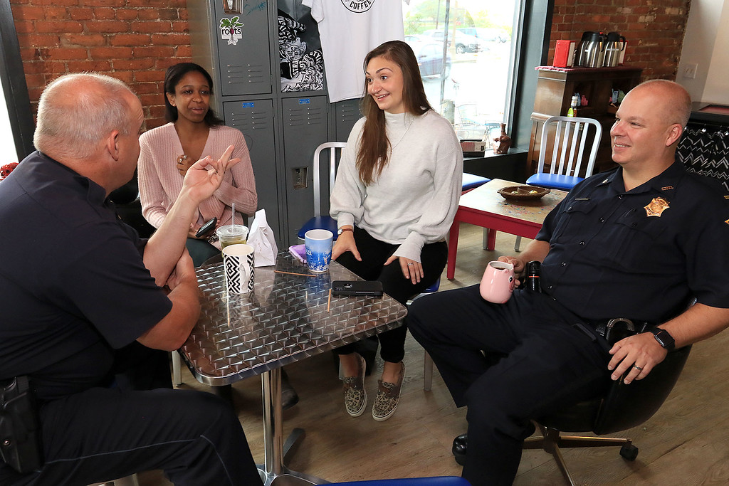 """. Wednesday was \""""Coffee with a Cop\"""" and in Fitchburg they held their event at Strong Style Coffee on Cushing Street. Chatting with Officer Fred Lake, l, and Lt. Jeffrey Howe is Chelsea Smith of Fitchburg and Sarah Keene with Lori Trahan\'s campaign. SENTINEL & ENTERPRISE/JOHN LOVE"""