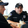"Wednesday was ""Coffee with a Cop"" in Leominster and they held their event at the McDonald's on Mill Street. Officer Mike Salovardos listens to retired NYPD police officer Tom Roller of Sterling who came down to chat with them during the event. SENTINEL & ENTERPRISE/JOHN LOVE"