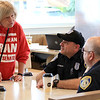 "Wednesday was ""Coffee with a Cop"" in Leominster and they held their event at the McDonald's on Mill Street. Officer Mike Salovardos and Interim Police Chief Michael Goldman listen to  Deborah Toivonen of Leominster during the event. SENTINEL & ENTERPRISE/JOHN LOVE"