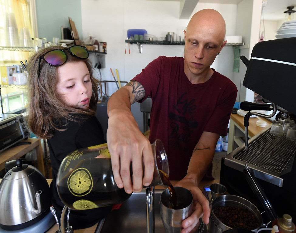 . Brice Young prepares a cold coffee at his store,  Precision Pours, in Louisville with elp from his daughter Cayper.  Cliff Grassmick  Staff Photographer August 1, 2017