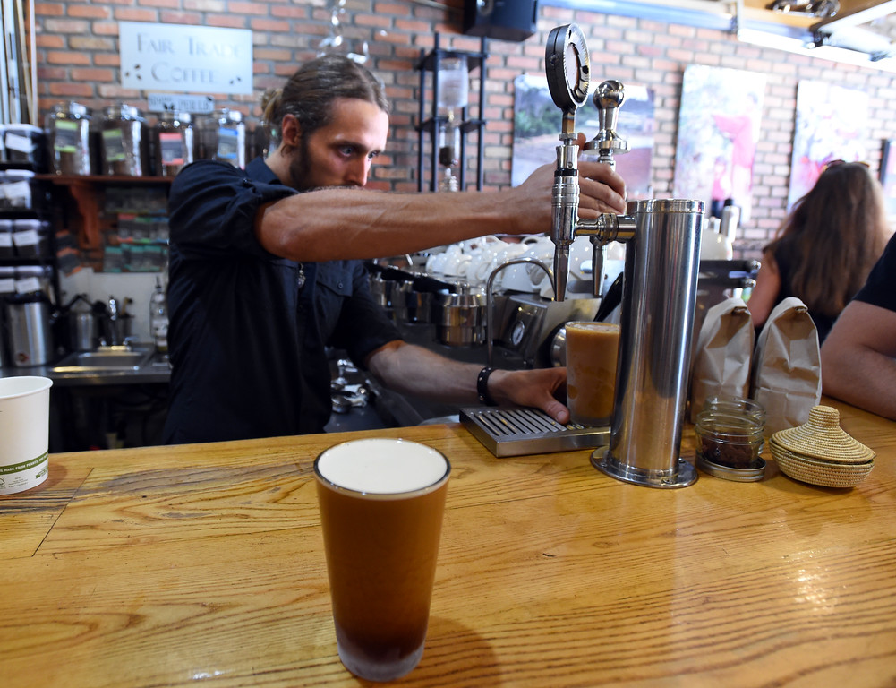 . Ethan Martin pours a nitro draft coffee (also one in the foreground)  at The Cup in Boulder on Friday.  Cliff Grassmick  Staff Photographer July 28, 2017