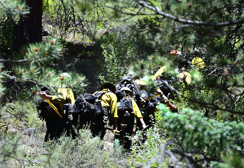 . Hot Shot firefighters walk up from Colo. Highway 119  to one of the burn areas. For more photos and a video, go to www.dailycamera.com. Cliff Grassmick  Staff Photographer  July 14, 2016