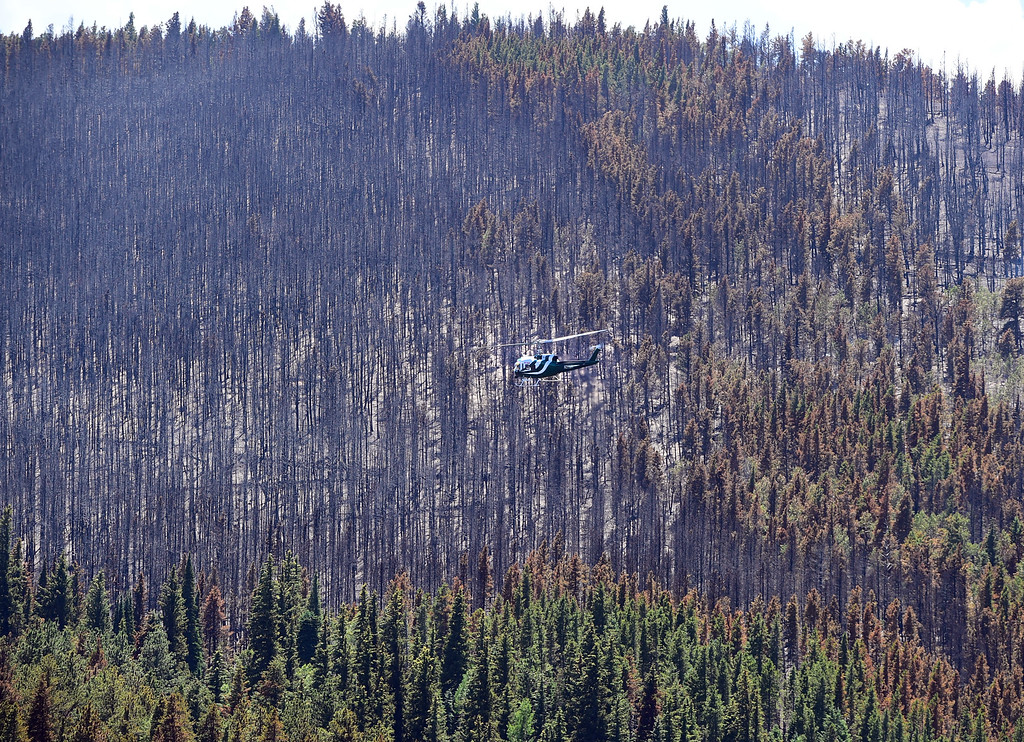 . Helicopters are transporting power poles to the burned areas on Thursday.  For more photos and a video, go to www.dailycamera.com. Cliff Grassmick  Staff Photographer  July 14, 2016