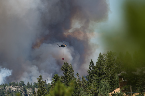 "A helicopter prepares to drop water on the Cold Springs Fire in Nederland on Sunday. <br /> More photos:  <a href=""http://www.dailycamera.com"">http://www.dailycamera.com</a><br /> (Autumn Parry/Staff Photographer)<br /> July 10, 2016"