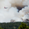 "A plane approaches the Cold Springs Fire as the fire spread rapidly due to heavy winds near Nederland, Colo. on Sunday. <br /> More photos:  <a href=""http://www.dailycamera.com"">http://www.dailycamera.com</a><br /> (Autumn Parry/Staff Photographer)<br /> July 10, 2016"
