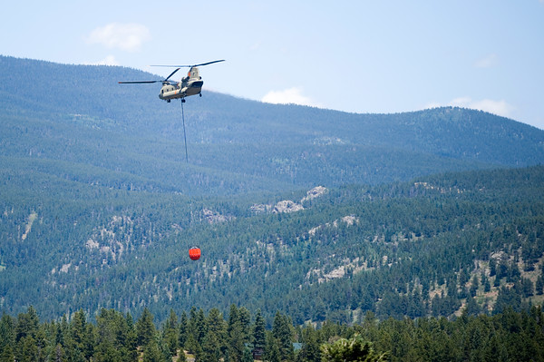 "A helicopter prepares for a water drop as they battle the Cold Springs Fire in Nederland on Sunday. <br /> More photos:  <a href=""http://www.dailycamera.com"">http://www.dailycamera.com</a><br /> (Autumn Parry/Staff Photographer)<br /> July 10, 2016"