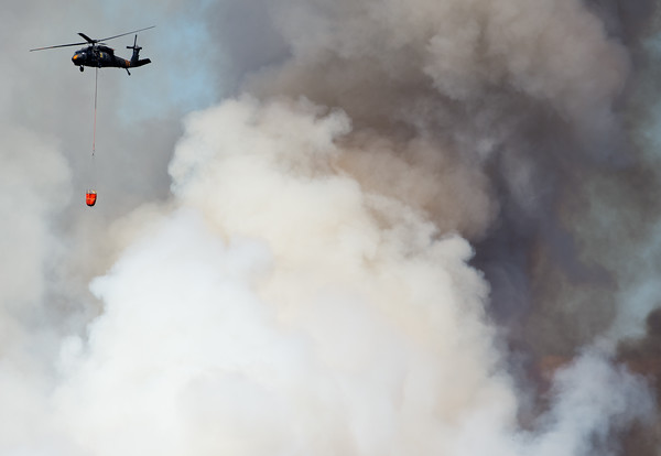 "A helicopter flies above the Cold Springs Fire in Nederland, Colo. on Sunday. <br /> More photos:  <a href=""http://www.dailycamera.com"">http://www.dailycamera.com</a><br /> (Autumn Parry/Staff Photographer)<br /> July 10, 2016"