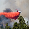 "A plane spreads flame retardant as they battle the Cold Springs Fire in Nederland on Sunday.<br /> More photos:  <a href=""http://www.dailycamera.com"">http://www.dailycamera.com</a><br /> (Autumn Parry/Staff Photographer)<br /> July 10, 2016"