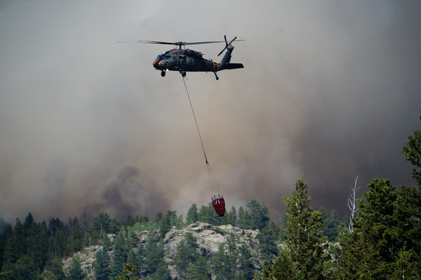 "A helicopter prepares for a water drop as they battle the Cold Springs Fire in Nederland on Sunday.<br /> More photos:  <a href=""http://www.dailycamera.com"">http://www.dailycamera.com</a><br /> (Autumn Parry/Staff Photographer)<br /> July 10, 2016"