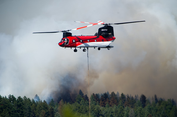 "A helicopter lowers a bucket into the Barker Reservoir to gather water which will be used to battle the Cold Springs Fire in Nederland on Sunday. <br /> More photos:  <a href=""http://www.dailycamera.com"">http://www.dailycamera.com</a><br /> (Autumn Parry/Staff Photographer)<br /> July 10, 2016"