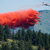 "A plane spreads flame retardant as they battle the Cold Springs Fire in Nederland on Sunday. <br /> More photos:  <a href=""http://www.dailycamera.com"">http://www.dailycamera.com</a><br /> (Autumn Parry/Staff Photographer)<br /> July 10, 2016"