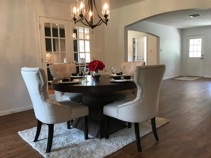 Intimate formal dining room arched top opening connects to the living area. Dining room and kitchen are separated by double French doors. Breakfast nook captures the morning sun with a large picture window.