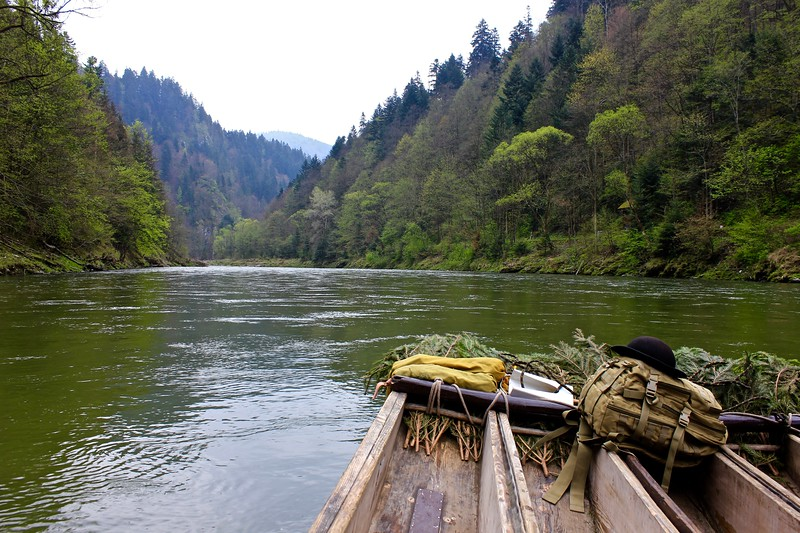 rafing on a wooden boat down the Dunajec River in Poland