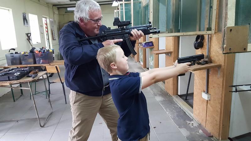 shooting a gun at Grotgun in Krakow, Poland