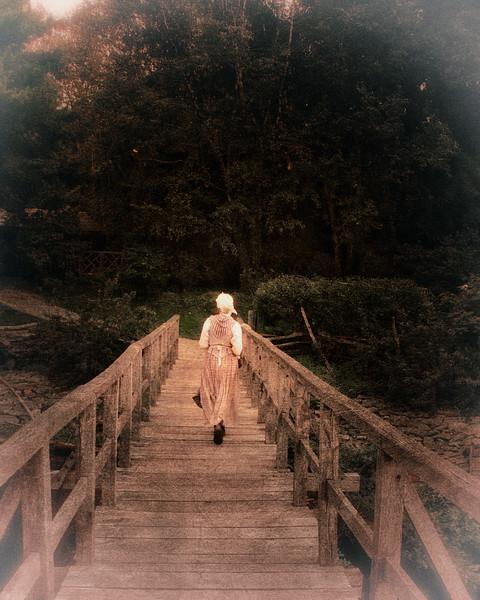 Costumed Interpreter Crosses Bridge At Philipsburg Manor, Sleepy Hollow, North Tarrytown, Westchester County, New York