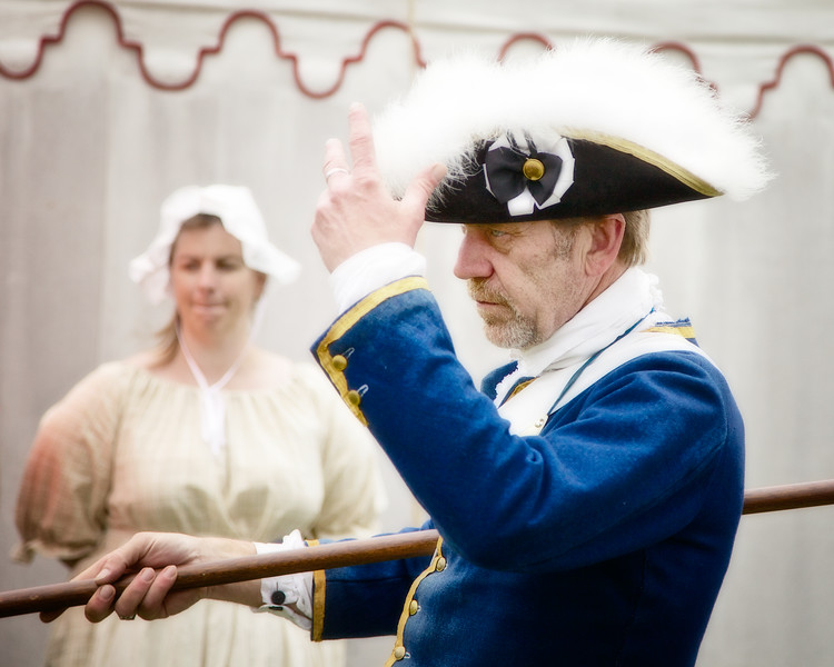 Revolutionary War Reenactments: British officer tipping his tricorn hat. Spirit of Vincennes Rendezvous, George Rogers Clark National Historic Park, Vincennes, Knox County, IN