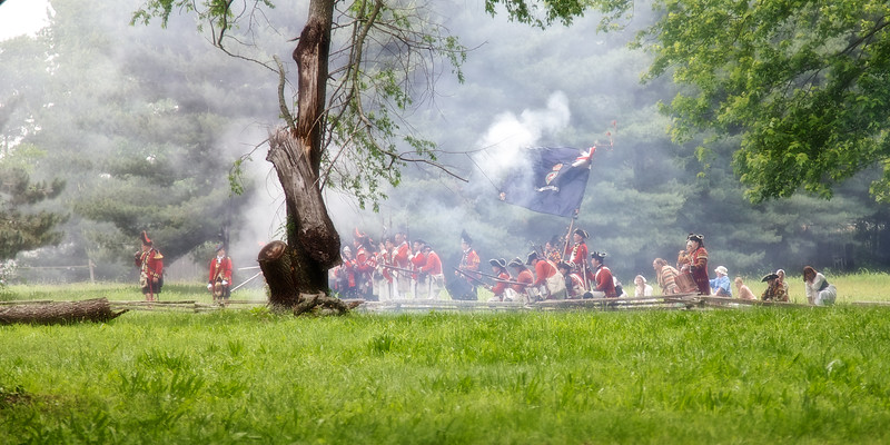 Revolutionary War Reenactments: British Redcoat Soldiers Reload After Firing Volley. Spirit of Vincennes Rendezvous, George Rogers Clark National Historic Park, Vincennes, Knox County, IN
