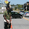 Nine year veteran of the Fitchburg Fire Deparment Yona Vaughan was on Bemis Road in the city Thursday, August 29, 2019 collecting for the Muscular Dystrophy Association. He made a hat/mask that look like a boot to help cheer up people that stopped to donate. SENTINEL & ENTERPRISE/JOHN LOVE