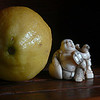 laughing Budha and lemon on teak