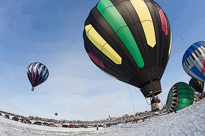 Hot air balloons during winter in Minnesota