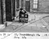 SK378891A, Man marking Ordnance Survey minor control revision point with an arrow in 1940s Sheffield