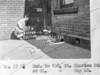 SK378857K, Man marking Ordnance Survey minor control revision point with an arrow in 1940s Sheffield