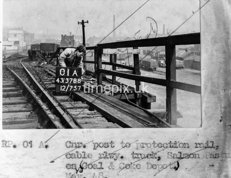 SK378801A, Man marking Ordnance Survey minor control revision point with an arrow in 1940s Sheffield