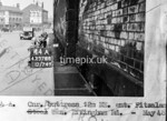 SK378844A, Man marking Ordnance Survey minor control revision point with an arrow in 1940s Sheffield
