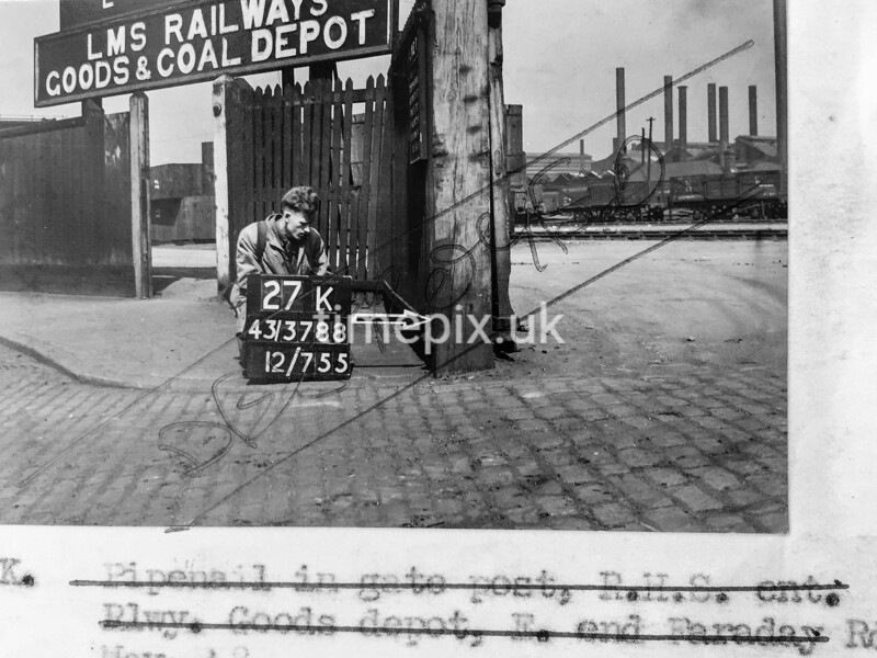 SK378827K, Man marking Ordnance Survey minor control revision point with an arrow in 1940s Sheffield