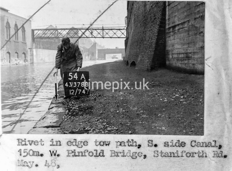 SK378854A, Man marking Ordnance Survey minor control revision point with an arrow in 1940s Sheffield